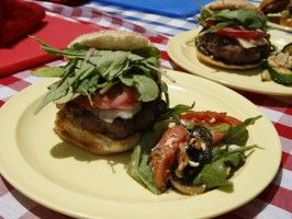 Big Fat Burger with Gruyere, Ham, Pickled Onions, Arugula, and Garlic Mayo from CookingChannelTV.com