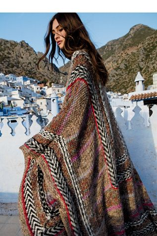 Heart of Glass Cape | Hand knit gorgeous and luxe space dyed cape pieced with different colors and patterns that all complement each other perfectly.  Made from hand-spun and hand-dyed super soft alpaca yarn, this heavyweight knit is the perfect cold weather must-have.