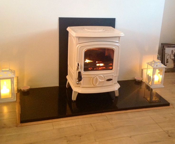 My Stanley Oisin cream enamel stove with polished black granite hearth ! I love it!