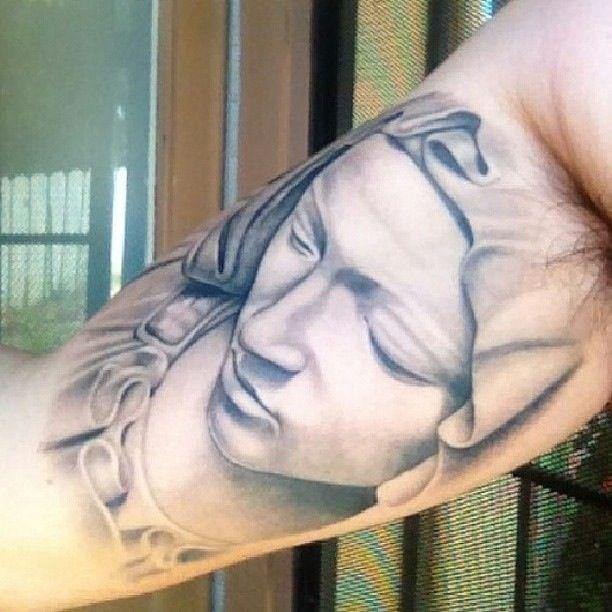 Virgin Mary tattoo by Lalo Pena.