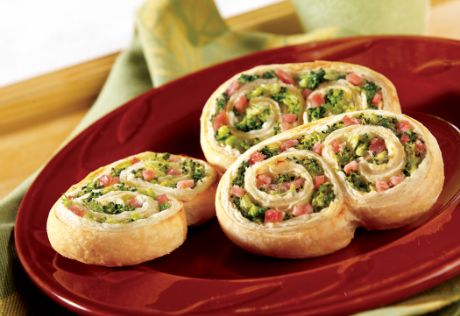 Broccoli, ham and chive-flavored cream cheese are rolled up in puff pastry and baked until golden for savory, flaky appetizers.