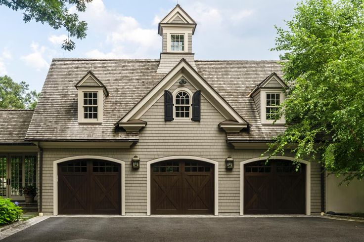 This three-car garage also doubles as an indoor basketball court. The design intention was to create a home that felt significant and timeless, without being ostentatious. It became a classic structure with traditional lines and materials that is nestled into the existing terrain.