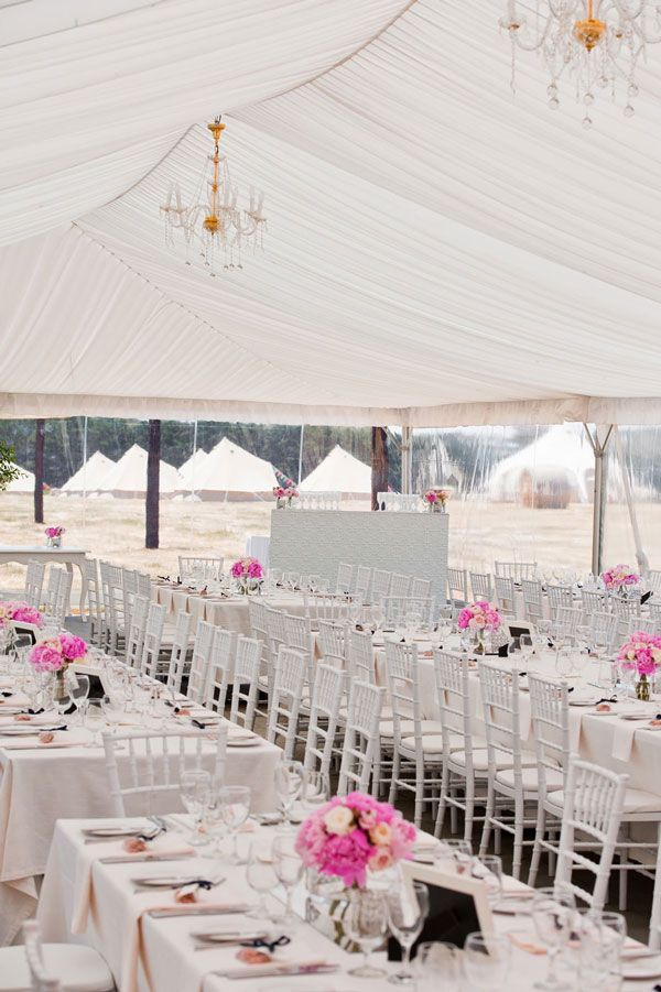 Two gold and crystal chandeliers hung over the tables