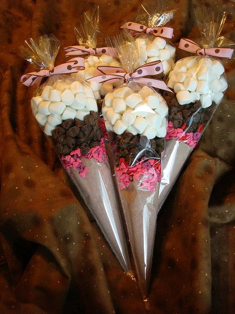 Valentine's Hot Chocolate Cones. Everything is in the cone for two chocolately mugs of delicious hot cocoa including chocolate chips, marshmellows and heart-shaped sprinkles to add bling. Great for party favors, wedding favors, etc. You could add Schnapps, or another favorite liqueur to make it an adult beverage.