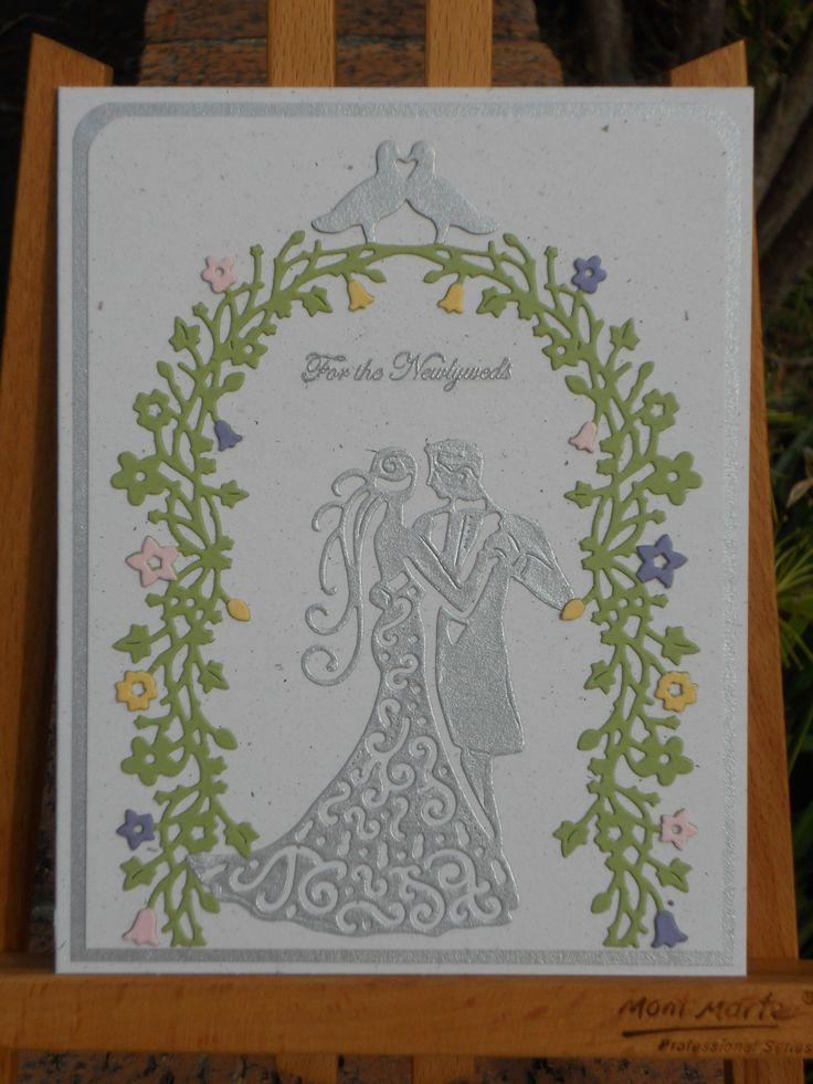 Using SU Naturals White CS and SU colours, Wedding card made with small pops of colours in the arch. Sentiment is embossed in silver. Used Tattered Lace Couples Die and Floral Arch.