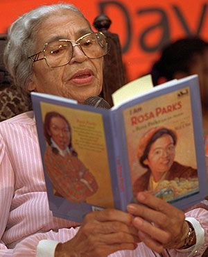 """ROSA PARKS (Civil Rights Activist  Heroine. USA, 1913-2005) reads from one of her books to children at the Tried Stone Baptist Church in Detroit."" from  ""Rosa Parks: More than a name in a textbook"" By Greg Toppo, USA TODAY,  10/26/2005."