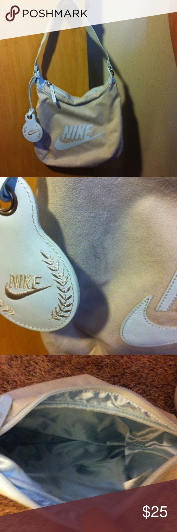 """Nike purse Vintage, 1980's, never used! Light blue (looks different colors in different lights), body is a soft material (pic 2) and handle/tag/logo are leather. Interior is baby blue satin looking with 1 zip pocket. H 11"""" x W 13"""", handle drop 1' Nike Bags"""