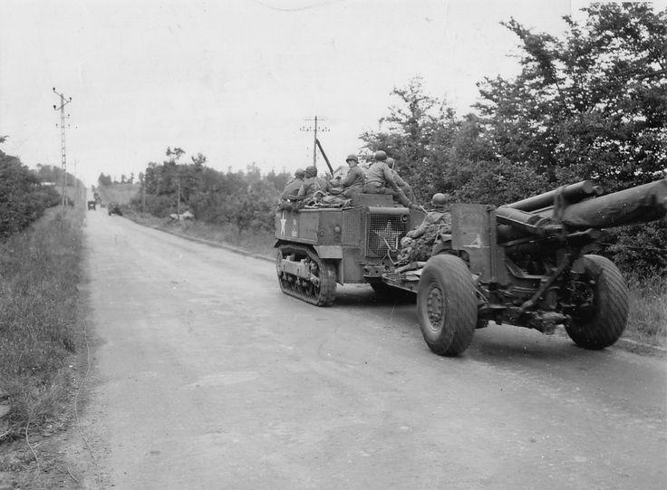 https://flic.kr/p/9YzcKi | p012363.jpg | Un canon 155mm Howitzer M1, tracté par un High Speed Tractor M5 (13t) sur la RN 13. Voir au début de ce film desTractor High Speed 13 ton, M5 (International Harverster Co) du 34th FA Bn de la 9th US ID. www.youtube.com/user/CombatReelsCom#p/u/16/vFZE9kKFTNU Une pin-up dessinée sur le bouclier du canon. Pour aller plus loin: en.wikipedia.org/wiki/155_mm_Long_Tom www.asphm.com/vehicules/m5_high_speed_tractor/m5_high_spe...