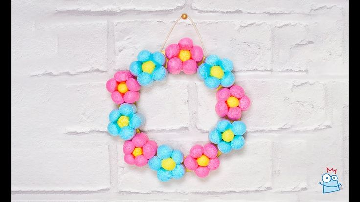 Take a look at how to make this fun, colourful and easy DIY flower wreath - The perfect quick make to keep your kids entertained.