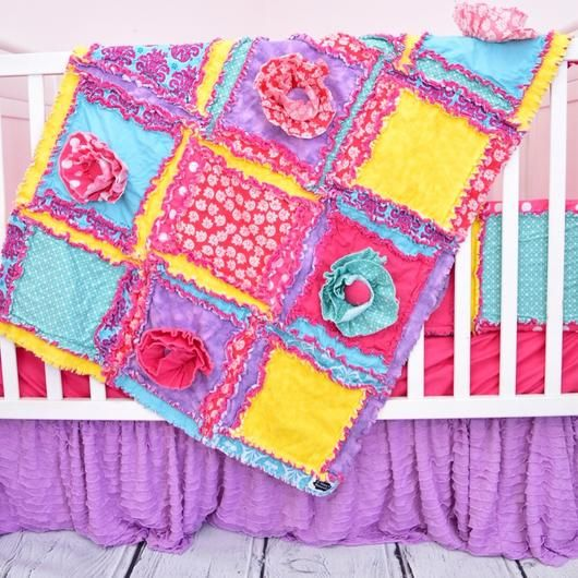 Baby Girl Ruffle Crib Bedding in hot pink, turquoise (aqua), and purple with 3-D ruffle flowers with fabric covered buttons in coordinating fabrics and a touch of lace. Sizes and Pricing Available in