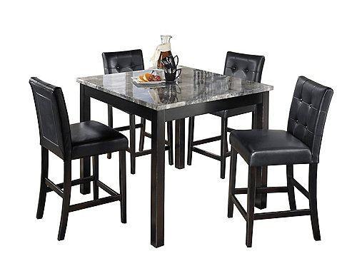 The Maysville 5 Piece Counter Height Dining Set Features A Square