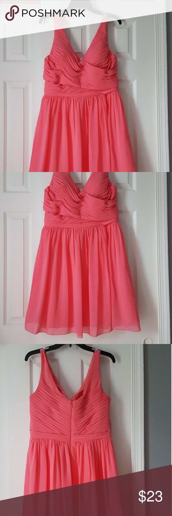 Beautiful summer event dress This pink coral cocktail dress is perfect for your summer event. The gathered fabric around the bust gives way to a flowing skirt and is very flattering. Says 14 but fits lime a 12. Bill Levkoff Dresses