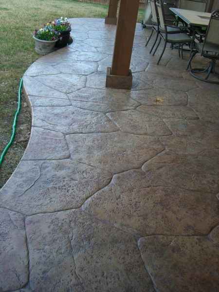 stamped concrete patio...much cheaper than flagstone or pavers and looks just as good! Except in grey