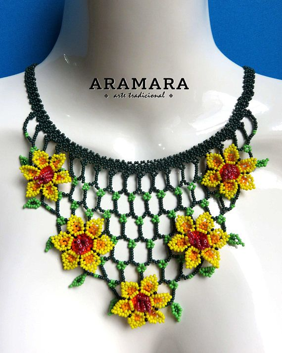 Dimension Necklaces length is 18 inches (45.72 cms) from point to point Necklaces hanging length is 11.5 inches (29.21 cms) Diameter of each flower is 1.6 inches (4.06 cms) Earringss length 2.6 inches (6.60 cms) The Huichol represent one of the few remaining indigenous cultures left in
