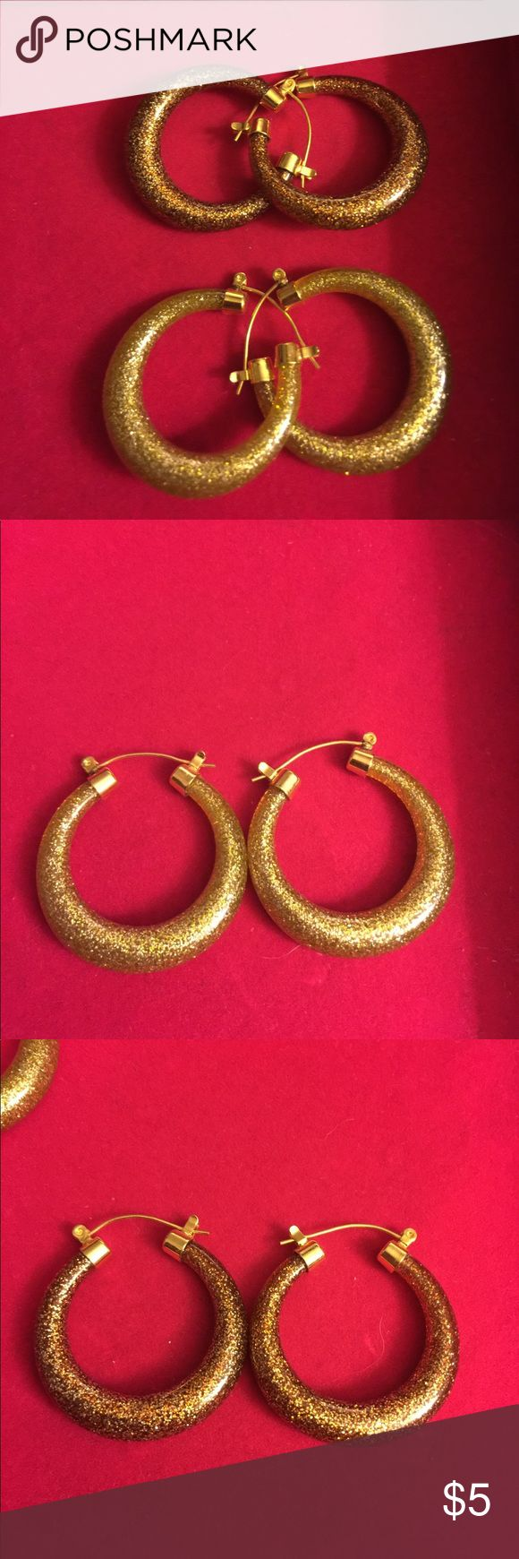 """Hoop earrings by Joan Rivers Hoop earrings by Joan Rivers. I had posted prior and had a buyer but I misplaced them and lost the sale. I found them again last night!  Made of lightweight resin. Approximately 1 1/4"""" wide. Two pair available; One pair = goldtone; one pair = copper tone.  Fashion earrings #joanriversearrings#hoopearrings Joan Rivers Jewelry Earrings"""