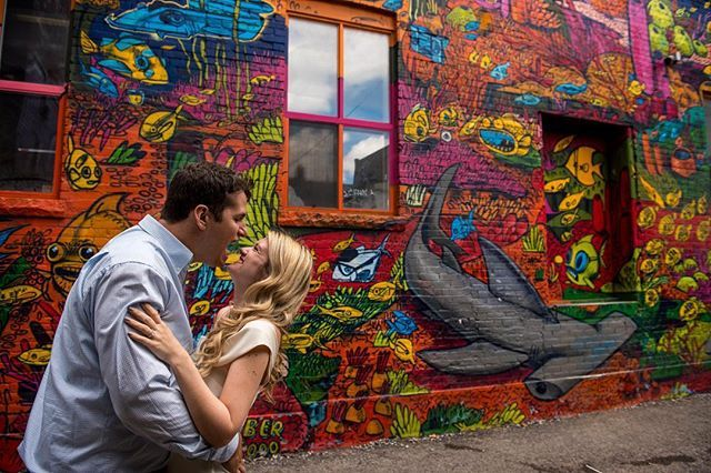 It's not often you find marine life in the city, but when you do it is best to imitate it :). #engaged a top place for engagement photos in Toronto is graffiti alley. The colourful background looks amazing in a guest signing book. #grafftialley #torontoengagementphotography.  Toronto engagement photography.