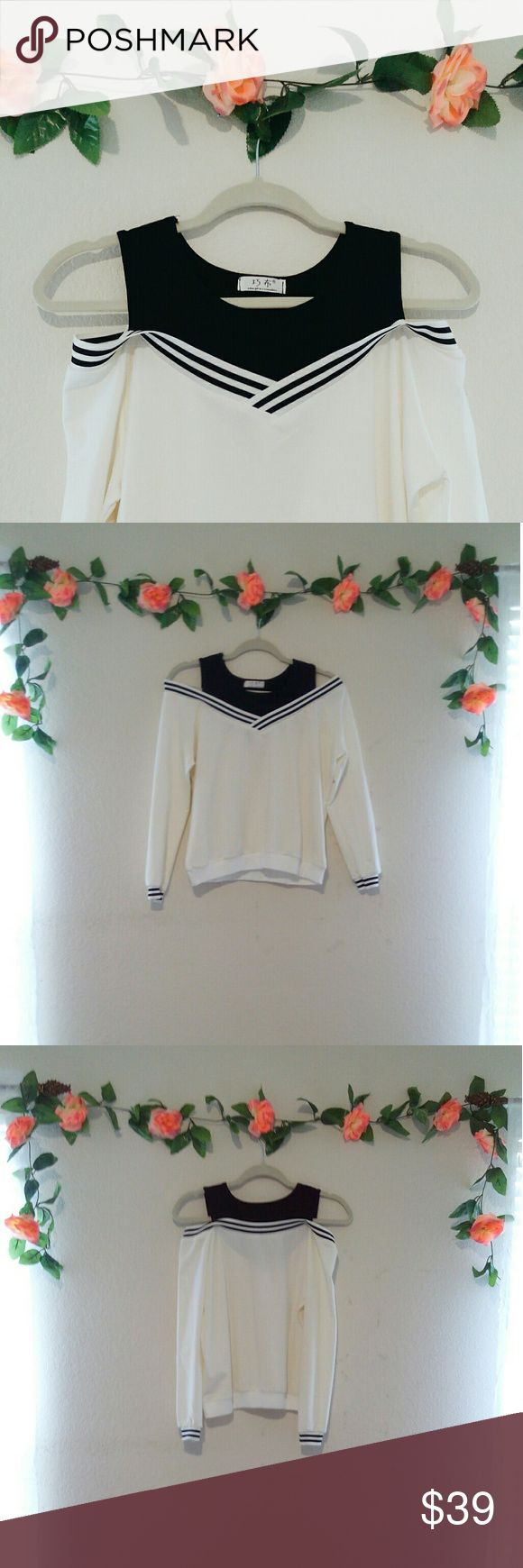 Mock Two Piece Sweater (NWOT) 🌹NWOT//Never Worn  This is a MOCK two piece sweater, so keep in mind that there is no actual undershirt!  If you wear a colorful or super dark bra, it might show a bit through the white fabric so I suggest going with a nude bra or wearing an undershirt.  Perfect for small sizes (medium for a fitted look).  *NOT by Brandy Melville!   Make a reasonable offer⛅ Brandy Melville Sweaters