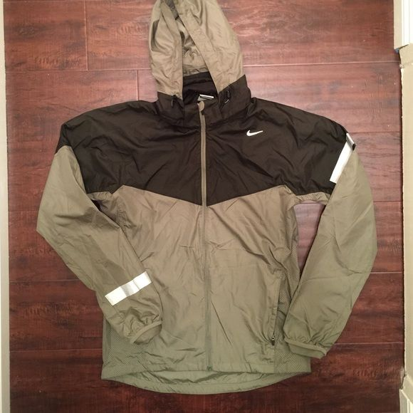 Nike Running Olive Windbreaker In great condition no visible flaws outside of wrinkles.  Bungees at the waist and hoodie.  Hood is removable, zip side pockets with velcro pocket in side.  Silver reflective accents.  Light and dark olive green!  Women's Medium = Men's Small.   Holds // PayPal // Drama // Comment Negotiations Respectful Offers Encouraged with Offer Button or Negotiation Post // Trades Selectively // Bundles Nike Jackets & Coats