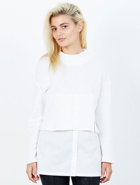 ISLA HOUSTON TOP from the Tribeca Collection. A little layering love without the heat, this cool white top is designed to look like a cropped cheesecloth knit over a crisp white shirt. With a deep yolk, drop shoulder and a split layered hem. With a concealed shoulder zip to make life easy. Available: www.islalabel.com  #islalabel #fashion #style #winter #white #top