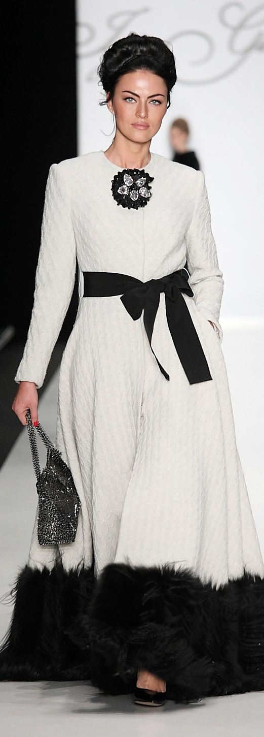:head to toe detail from the brooch to the ribbon belt to the soft fur...and it works: