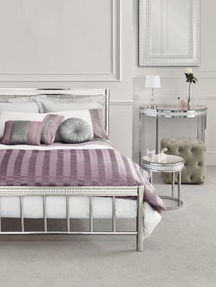 Doesn't this bedroom just ooze glamour!? Our Gleam bedstead pairs perfectly with lilacs and silvers!
