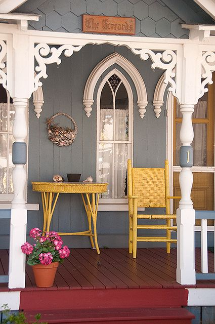 Cottage porch with white gingerbread trim and yellow wicker funiture. Photo by jskovac, via Flickr