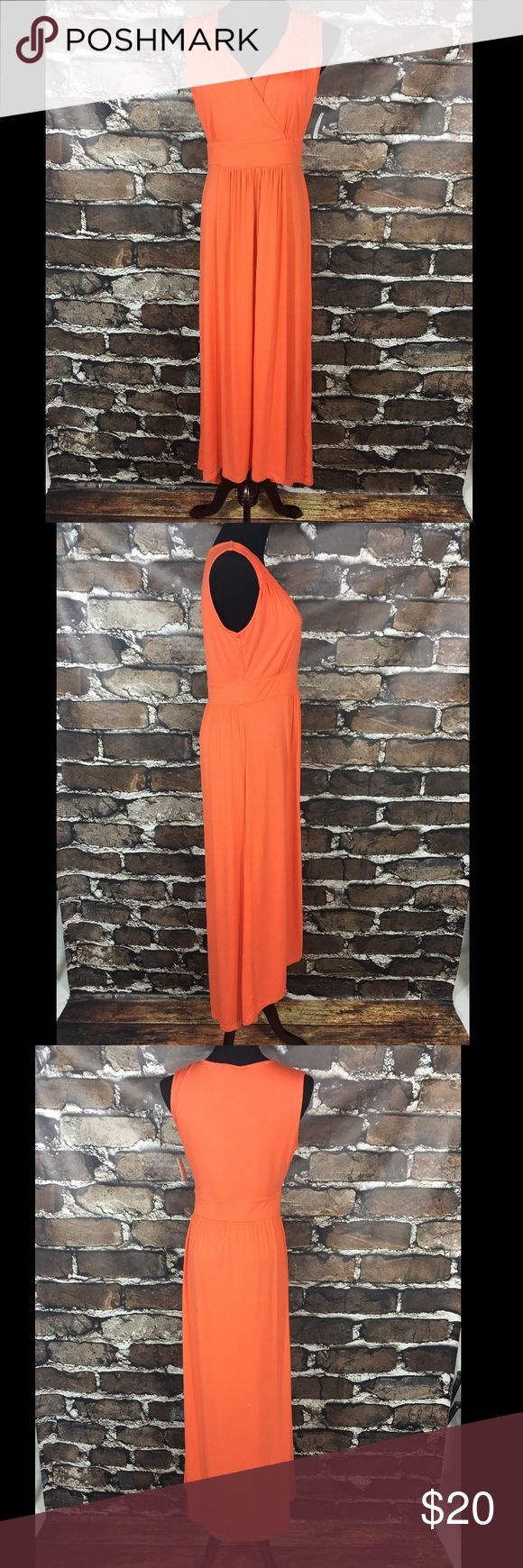 "NWT Tribal Hi-Lo Maxi Dress New with tags. Women's dress by Tribal. Orange. Maxi dress. Sleeveless. Slight hi-lo. Stretch. Women's size medium.  Measurement done without stretch: 38"" bust, 49.5"" length (front), 56"" length (back).  95% rayon, 5% spandex.  No rips, tears, stains, or flaws. From a smoke free home.  B020 Tribal Dresses Maxi"