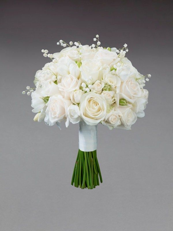 Grey accents to white and cream: Cream Rose and Freesia Bridesmaid Bouquet