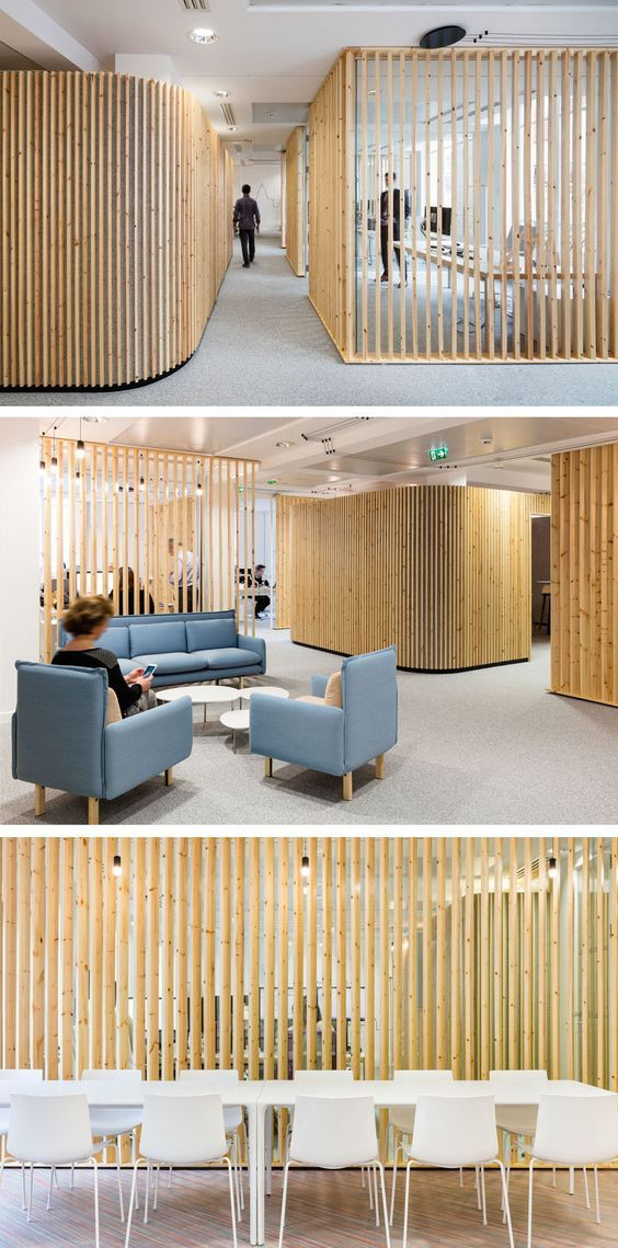How to make a design impact using simple pieces of wood //  For this office space, Studio Razavi architecture used basic pine lumber, installed vertically, to create a distinct look for an insurance company headquarters.: