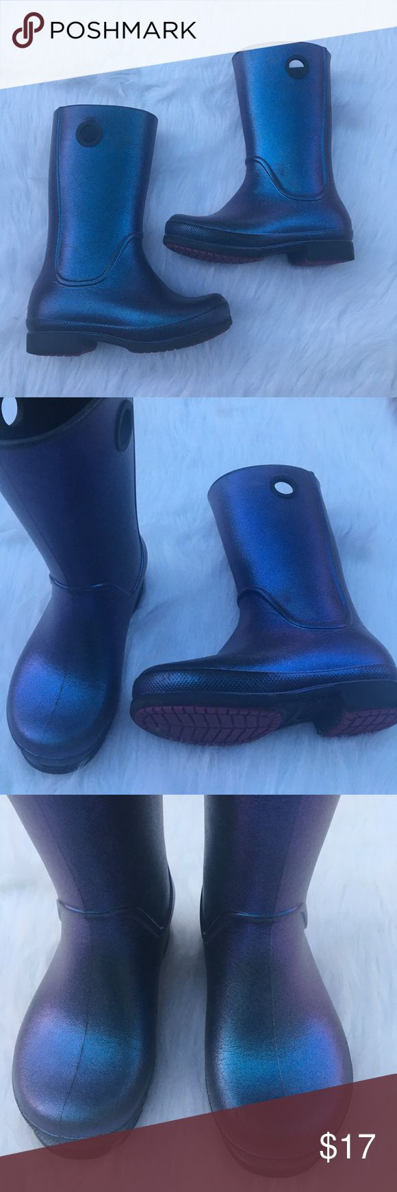 "Crocs Welli Iri Girls Rain Boots sz 12 Aegean Blue Crocs Welli Iridescent Girls Rain Boots sz 12 Aegean Blue with black. Worn few times - runs small. Daughter is a size 11 wide and these will not fit on her foot. Recommended for a smaller foot size or narrow foot. Measures approx 9"" tall from top to bottom, soles measures 7 1/2"" x 2 1/2"". Some wear and scuffing as shown. CROCS Shoes Boots"