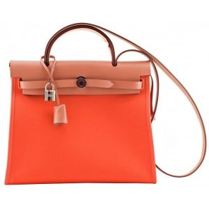 Hermes 1t 50% OFF | Herbag Zip PM Orange from Hermes. This stunning herbag is made of perfect combination between Orange Canvas and Natural leather flap top with a silver palladium hardware. It comes in one shoulder strap and handle to carry in the hand or shoulder. It has one removable zipped small flat pocket inside and has one outside back zipper pocket. A MUST-HAVE to all Hermes Fans!