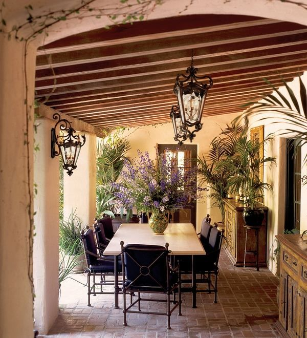 rustic outdoor lighting ideas dining furniture wrought iron chairs wall ceiling lanterns covered patio design
