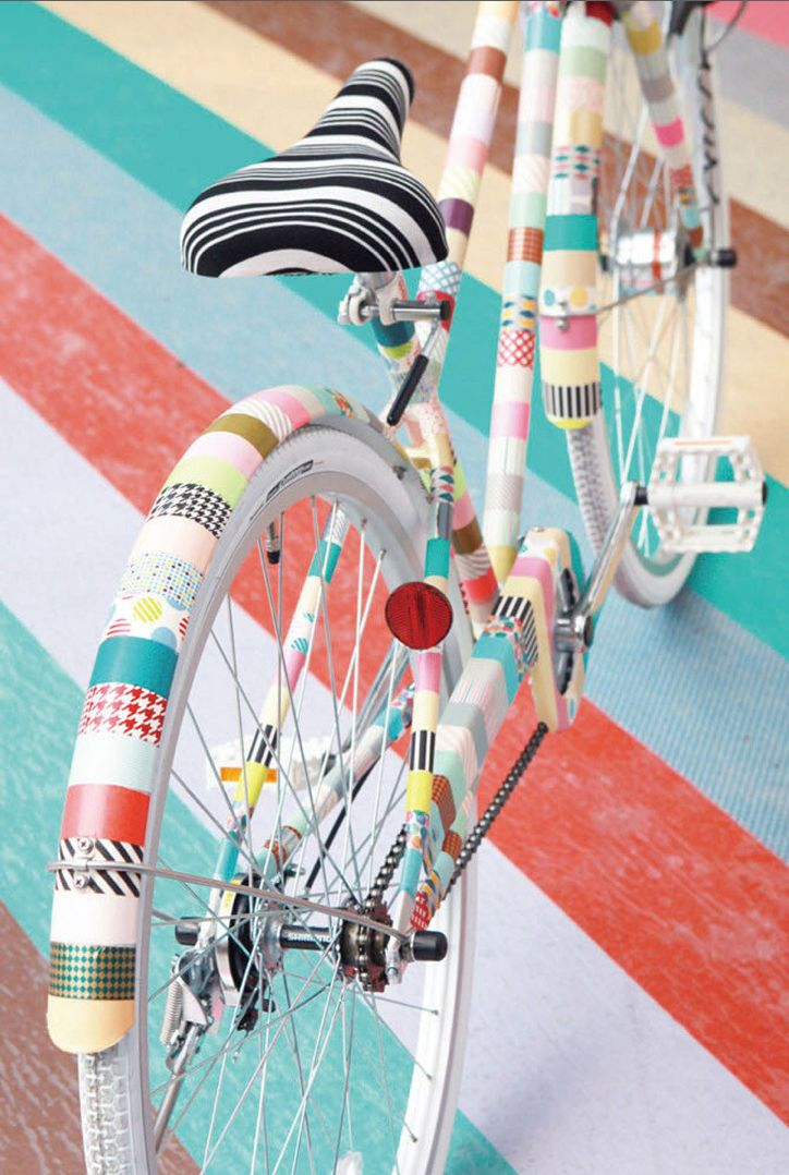 Okay, tell me, who wouldn't want a bike as colorful as this one? Can you believe that this is covered in washi tape?