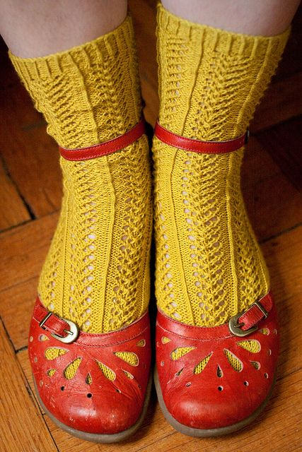 With yellow hand-knit socks.