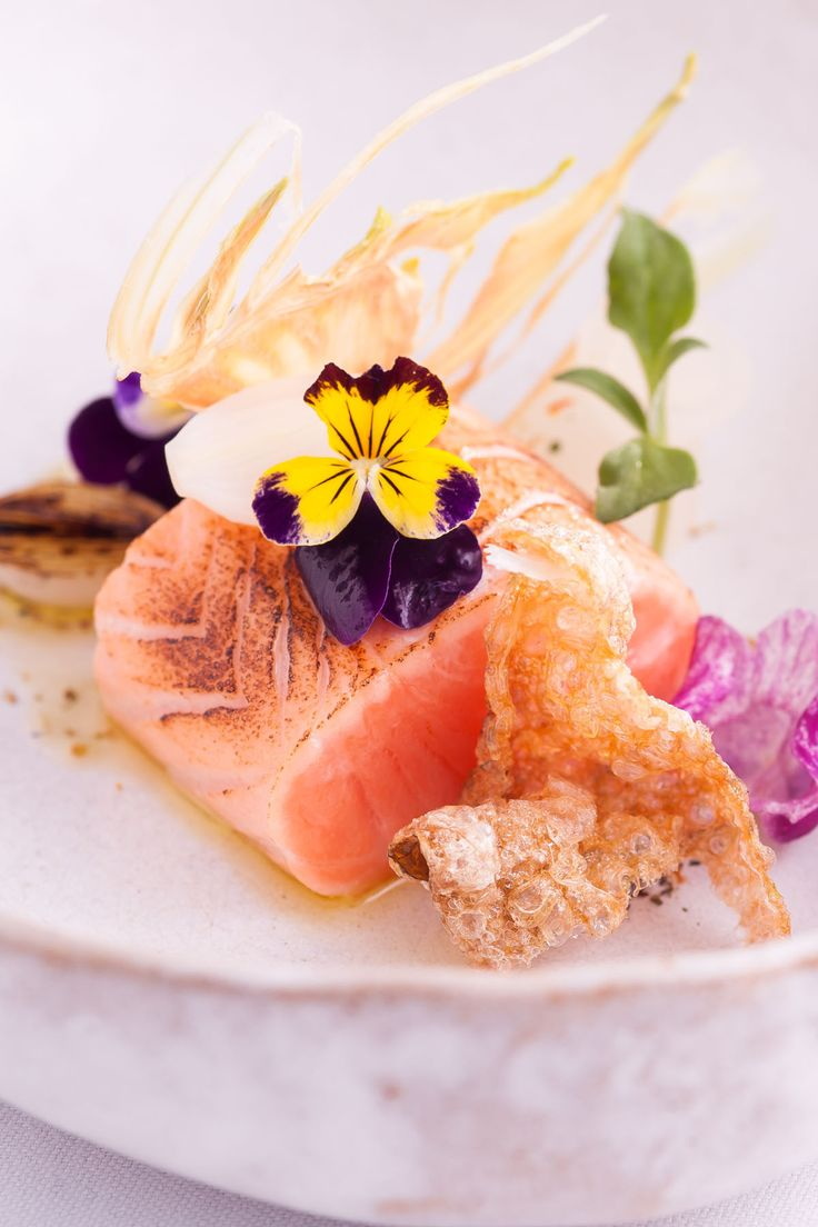 This delicious starter by Michelin-starred chef Lisa Allen has many elements that come together to create a striking dish, bursting with vibrant colours. To give the salmon a smoky, charred flavour the chef finishes the dish by lightly blowtorching the flesh.
