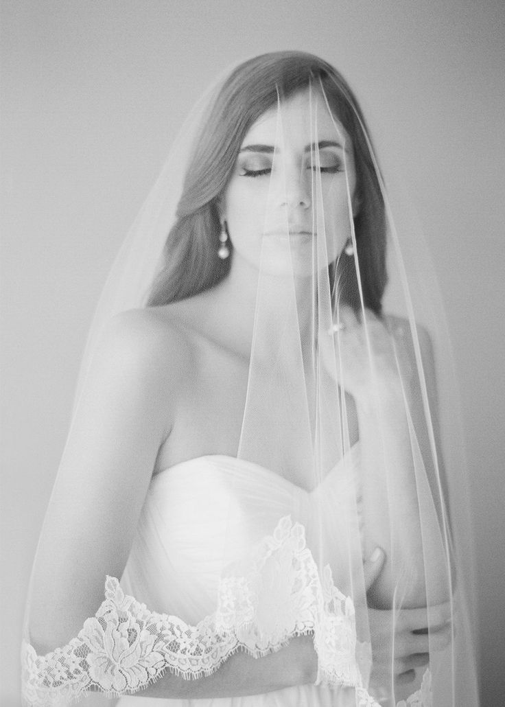 The Marguerite chapel length veil exudes old world charm and an enchanting aesthetic to breezy, classic and modern silhouettes.