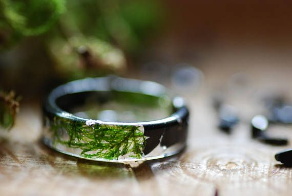 Black Tourmaline Resin Ring with Real Moss and 925 Silver flakes. A flat thin smooth band ring made with Black Tourmaline stones, real moss and 925 silver flakes in clear Eco resin. Black Tourmaline is also a powerful grounding stone, electrical in nature, providing a connection between