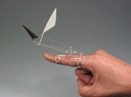 Da Vinci-esque jewelry flies on your hand... Metal smith and jewelry maker Dukno Yoon creates small kinetic sculptures that turn your ring finger into your wing finger. For animated image, go here... http://news.cnet.com/8301-17938_105-57398450-1/da-vinci-esque-jewelry-flies-on-your-hand/?part=rss&subj=news&tag=title