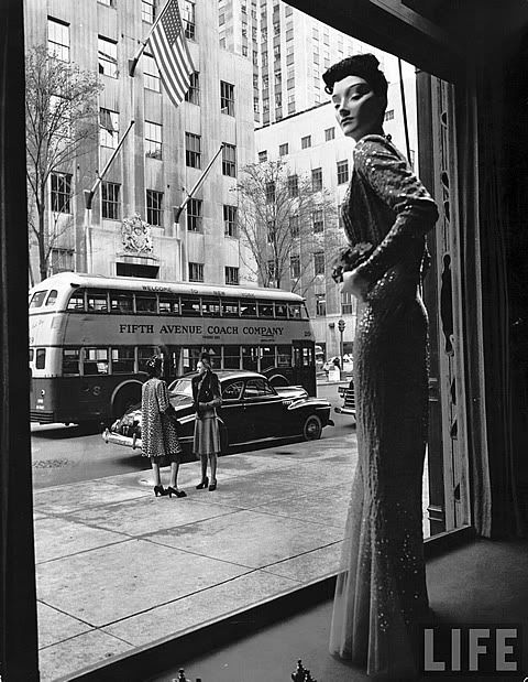 Vintage 1940s black & white photograph New York City fifth avenue fashion store window display.