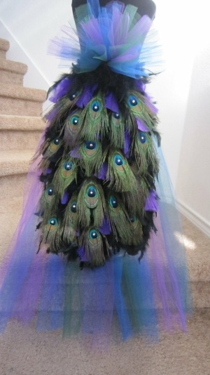 I am so into peacock right now! dying to have a reason to make a peacock dress!!! amazing peacock costume, i think this is the back