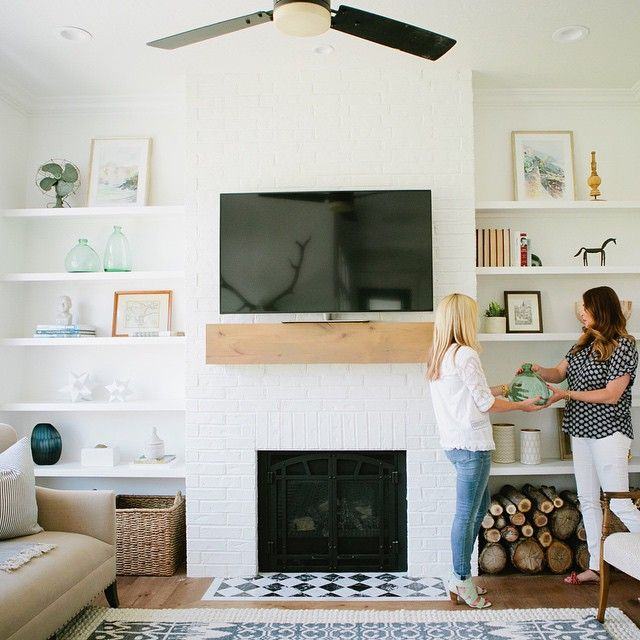 Simple shelf styling in the #modernfarmhouseproject den. Photo by @lindseyorton