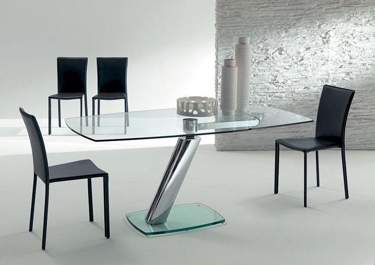 ZETA. Design, function and technology mix together to create a geometric design of defined sign. Extending dining table, central metal column with glass base, glass top and visible extension under the top. http://www.easy-line.it