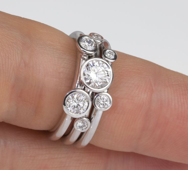 Multiple diamond stacking rings. Three bands, with bezel set diamonds, interlocking. Can be worn as singular rings or as a three ring stacked set for maximum impact. Largest diamond for reference is a certified 0.50cts diamond.