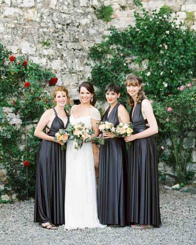 Lauren's bridesmaids were her sisters. Lindsey and Mary Helena, and her sister-in-law, Eleanor. They wore identical Twobirds dresses in slate gray.