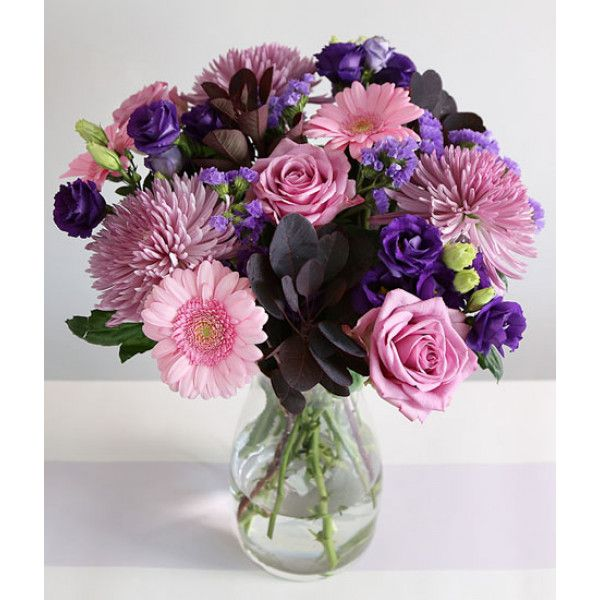 A pretty #arrangement of #pink and purple hues, that features a mix of both seasonal and classic stems including Chrysanthemum #blooms, #roses, germini, lisianthus, cotinus and statice. A perfect choice as a gift for a female relative, friend or colleague.