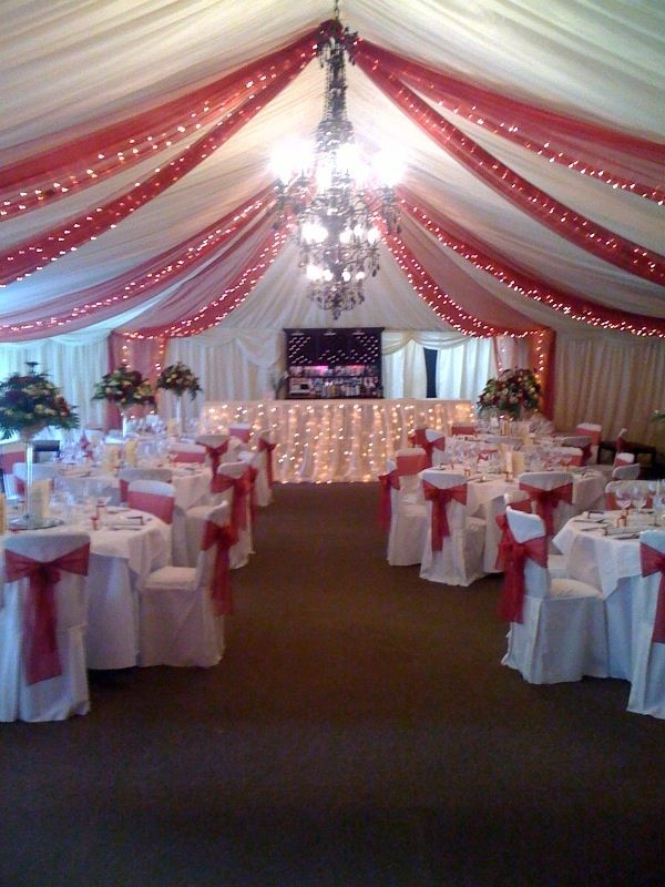 Christmas wedding decor! I love the tulle decor on the ceilling