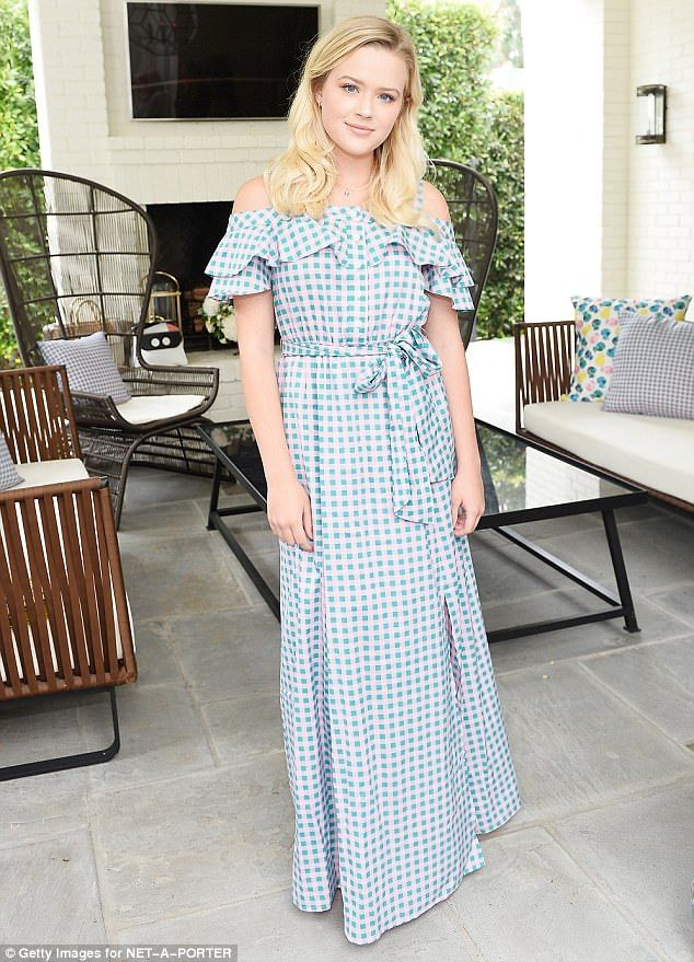 Looking like the belle of the ball:Her daughter Ava cut a stylish figure in a blue and wh...