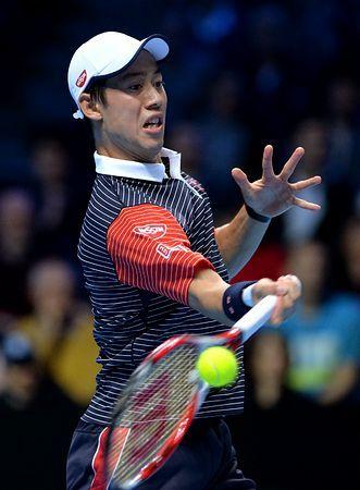 ATPツアー・ファイナルのフェデラー戦でリターンショットを放つ錦織圭=11日、ロンドン(AFP=時事) ▼12Nov2014時事通信|傷を広げた序盤のほころび=錦織、響いたサーブミス-ATPファイナル http://www.jiji.com/jc/zc?k=201411/2014111200012 #ATP_World_Tour_Finals_2014