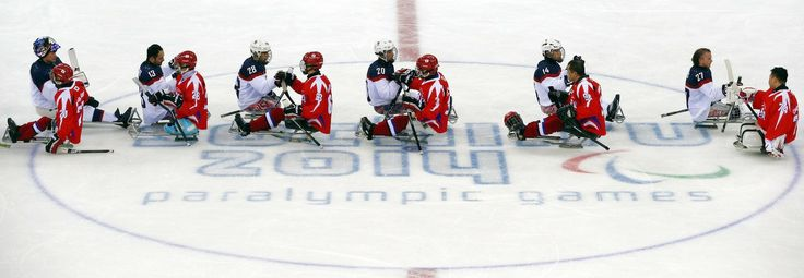 South Korean and American players shake hands after their ice sledge hockey match at the 2014 Winter Paralympics in Sochi, Russia, Sunday, March 9, 2014. United States won 3-0. Image: Pavel Golovkin/Associated Press  #Paralympics #AdaptiveSports #SledHockey #Hockey