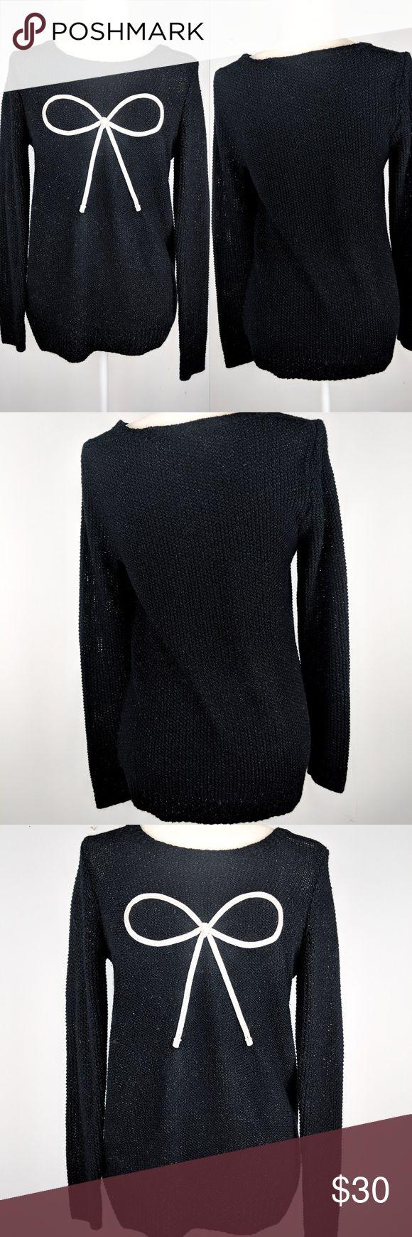 {lauren conrad} lurex bow sweater Lurex bow sweater from LC Lauren Conrad in black and cream. Metallic threading adds a slight glitter effect. Excellent condition! Size medium. LC Lauren Conrad Sweaters Crew & Scoop Necks